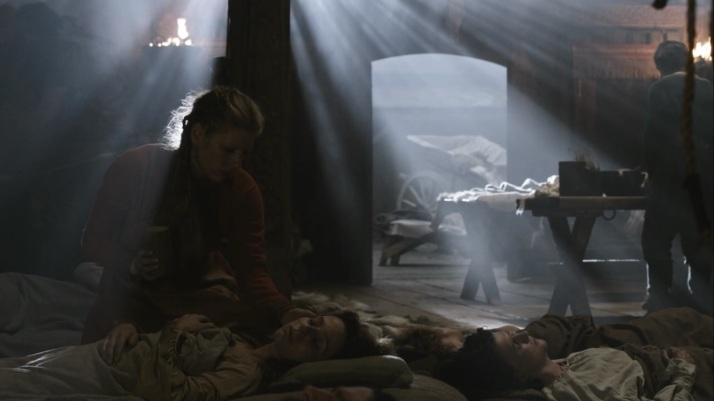 the sickness strikes all and lagertha tries to care for them