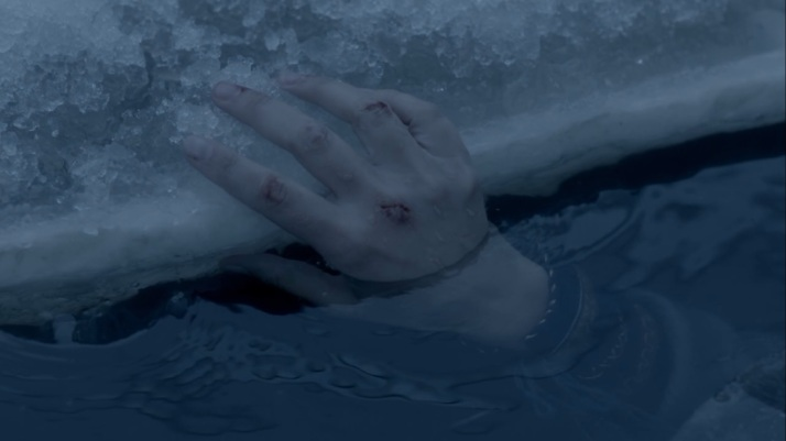 siggy's hand clings to the ice and to life for a moment longer