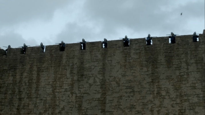 a sheer wall topped by well trained archers