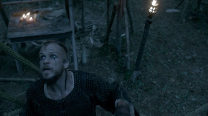 floki communes with the gods as helga runs away in fear