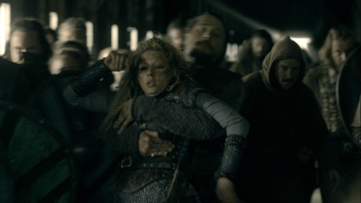 Lagertha her stubborn self will not listen so Kalf does what he has to and drags her back out of the way.