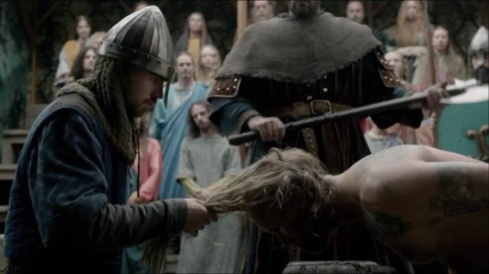 not wanting it said they deny someone of a last wish  they comply and a man holds sigfrid's hair back.