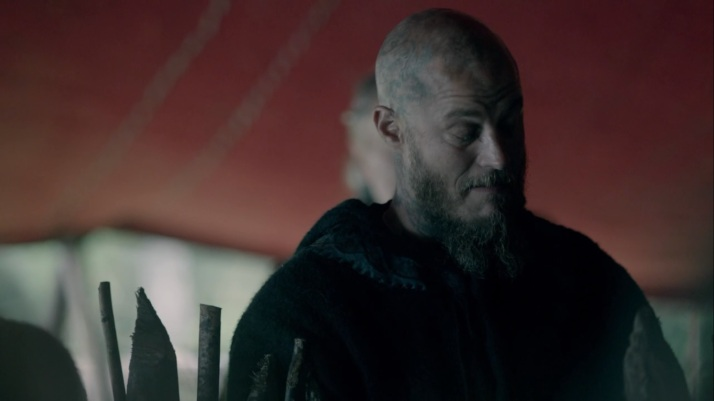 ragnar tries to hide his smug amusement at floki's flustered unease