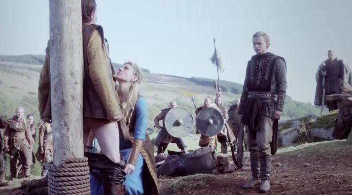 sleazy Erlandeur and Kalf look on while Lagertha prepares to unman Einar