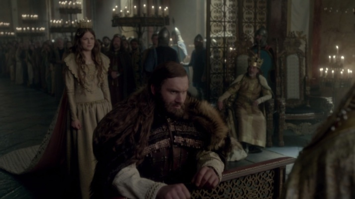 rollo follows the cue and kneels not all that happily himself