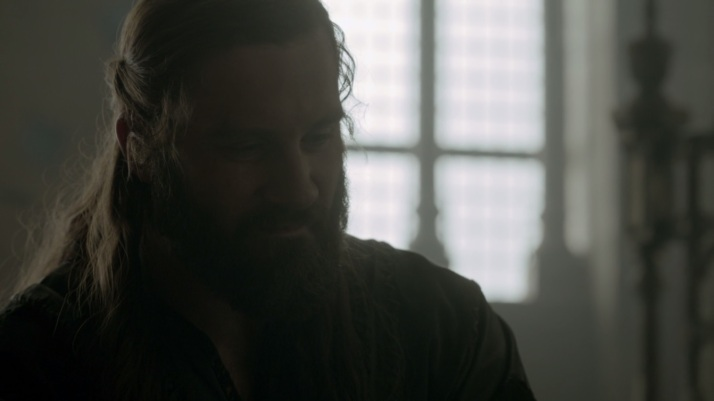 rollo has an underneath the breath laugh at Eirik's statement that they want him to come back to the camp so they can talk to him Rollo knows