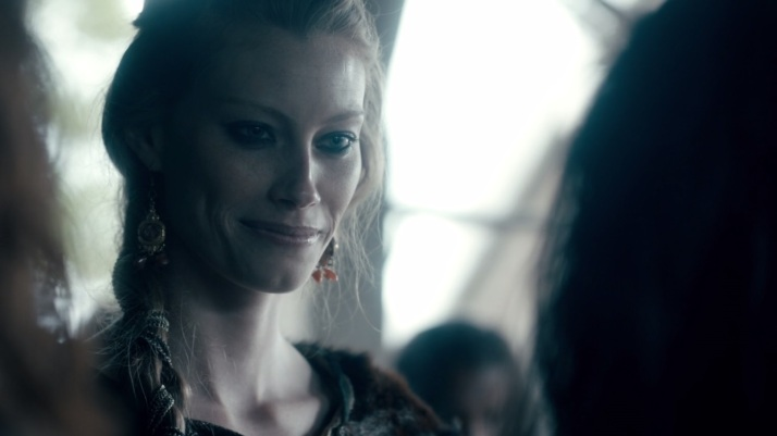something about this slave causes aslaug to think and smile