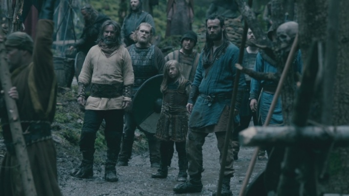 there are a few men smiling at rollo's appearance but not eirik