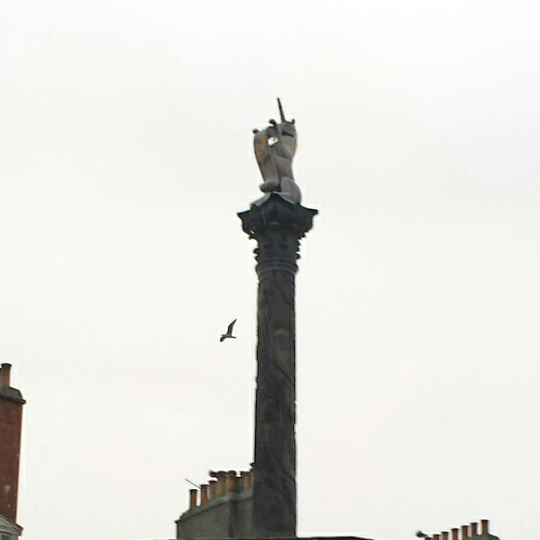 close up of unicorn at top of mercat cross