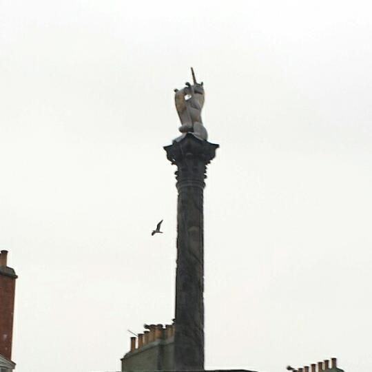 close up of unicorn at top of mercat cross
